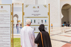 Sheikh Zayed Mosque with Touristsare Reading Information, The Great Marble Grand Mosque at Abu Dhabi, UAE Stock Image