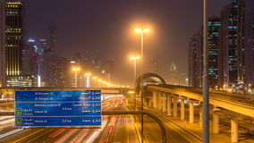 Sheikh Zayed road traffic day to night timelapse and Dubai Metro. Dubai, UAE. stock footage
