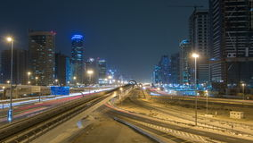 Sheikh Zayed road traffic night timelapse and Dubai Metro. Dubai, UAE. Sheikh Zayed road traffic night timelapse with Dubai marina and jlt skyscrapers. Line of stock video