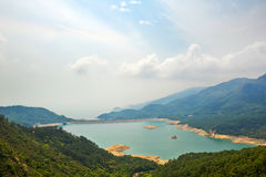 Shek Pik reservoir and clouds Stock Photo