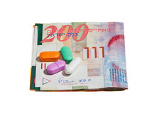 Shekel Currency and Pills Royalty Free Stock Photos