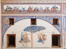 Old indian home fresco, men and women having fun and walking elephant riders Stock Photos