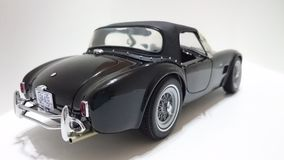 Shelby Cobra hard top roadster in black Stock Photography