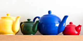 Shelf with assorted teapots Royalty Free Stock Photo