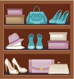 Shelf with bags and shoes. Royalty Free Stock Photo