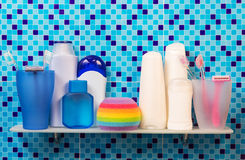 Shelf in the bathroom with toothbrush and other hygiene products Royalty Free Stock Photos