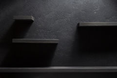 Shelf and black wall wood Stock Image