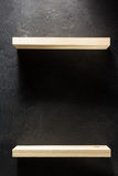 Shelf and black wall on wooden Stock Image