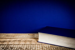 Shelf with a book and a blue wall Royalty Free Stock Photo