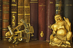 Ancient books, Buddah and sextant Stock Image