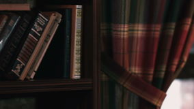 Shelf with books close-up stock footage