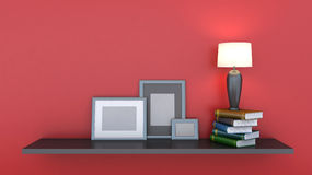 Shelf with books and lamp Stock Images