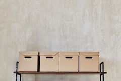 Shelf with boxes and books royalty free stock images