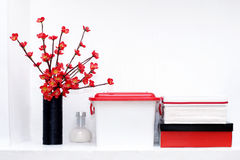 Shelf with a boxes and flowers Stock Photos