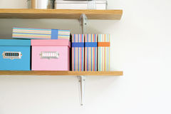 Shelf with boxes and file Royalty Free Stock Images