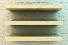Shelf on brick wall Stock Image