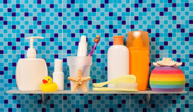 Shelf with children bath accessories Stock Images