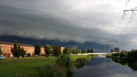Shelf cloud above the Nesselande district in Rotterdam, The Netherlands where an aircraft is flying trough.  stock image