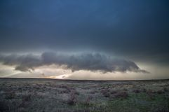 The shelf cloud of a supercell thunderstorm looms over the high plains of eastern Colorado. The shelf cloud of a supercell thunderstorm looms over the high stock photo