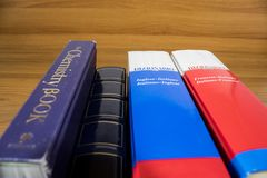 A shelf of colored book in a wood backgorund. Composition royalty free stock photography