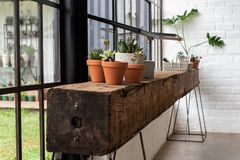 A shelf or counter made from a beam of wood. A rustic shelf or counter made from a heavy beam of old wood stock photography