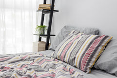 Shelf decorating a bright modern bedroom Royalty Free Stock Photo
