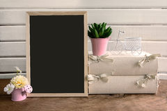 Shelf decoration with blackboard and flower on white background Royalty Free Stock Photo