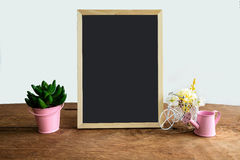 Shelf decoration with frame and flower on white Stock Photos