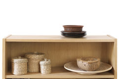 Shelf with decorative elements. Wooden shelf with decorative elements on white background Stock Images