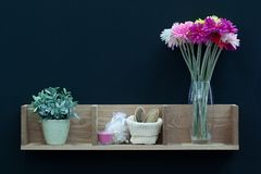 Shelf with flowers and premiets of hygiene. In a stylish interior stock photo