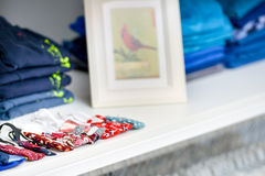 Shelf with folded shirts Royalty Free Stock Images