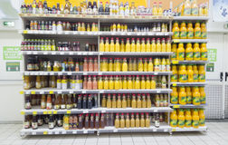 Shelf of fruit juice in Carrefour supermarket of Iasi city, Romania Stock Photo