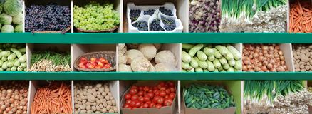 Shelf with fruit and vegetables bulk grocery. Shelf with fruit and vegetables apricot onion carrots red cabbage potatoes beet green onions pumpkin grapes peach stock photos