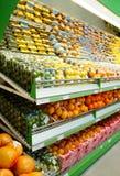 Shelf with fruits Stock Photos