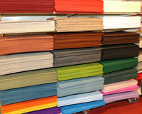 Shelf full of fabrics for sale at the fair for decoration and le. Shelf full of fabrics and felt for sale at the fair for decoration and leisure time Stock Image