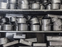 Shelf full of pans. All in chrome royalty free stock images