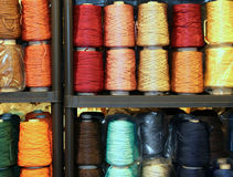Shelf full of skeins of colored threads of wool and cotton for s Royalty Free Stock Photo