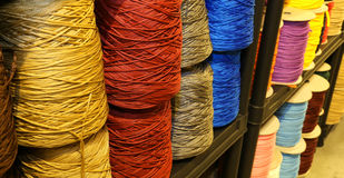 Shelf full of skeins of colored threads of wool and cotton for s Royalty Free Stock Images