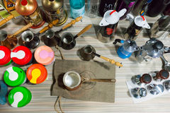 Shelf full of various candle holders and cups Stock Photography