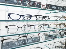 Shelf with glasses in eyewear store stock photography