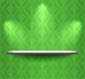 Shelf on the green wall Royalty Free Stock Photo