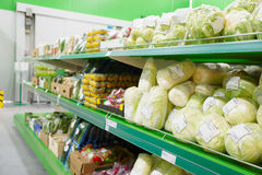 Shelf with groceries in supermarket Stock Photo