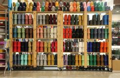 Shelf of haberdashery with lots of threads and wadding Stock Photos