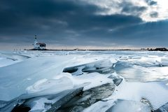 Shelf ice and lighthouse Stock Image