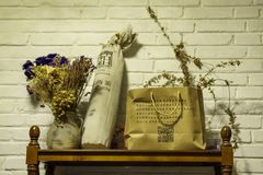 On the shelf of the inn. The furnishings of the inn, a clay pot filled with dried flowers and grass, some daily necessities royalty free stock photography