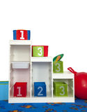 Shelf in  kindergarten. Shelf in kindergarten with numbered boxes on it Royalty Free Stock Photos