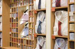 Shelf with men  wear in store Royalty Free Stock Photos
