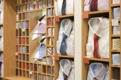 Shelf with men  wear in store. Shelf with men  wear in shop Royalty Free Stock Photos