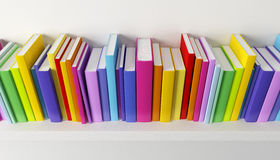 Shelf with multicolored books Stock Photography