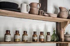 Shelf of old glass bottles Royalty Free Stock Photos